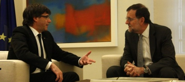 Puigdemont (left) asks Rajoy to hold a binding referendum in Catalonia